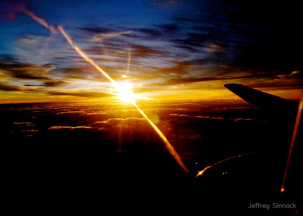 sunset at thirty two thousand feet by Jeffrey  Sinnock