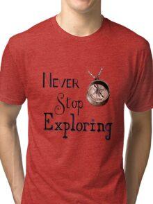 Never stop exploring  Tri-blend T-Shirt