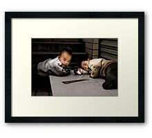 Playing with matches Framed Print