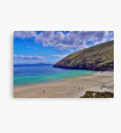 Walkers On Keem Beach, Achill Island Feted By The Green Atlantic Ocean. Canvas Print