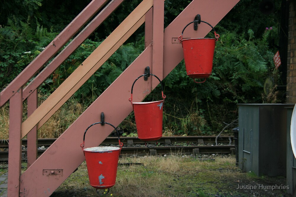 Fire buckets in red by Justine Humphries