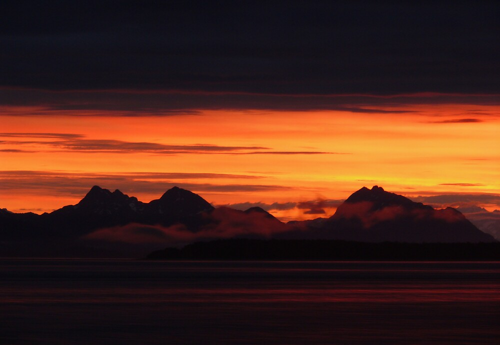 Mountainous Sunset Silhouette by Josh Meggs