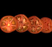 Whole sliced tomato by Jeffrey  Sinnock