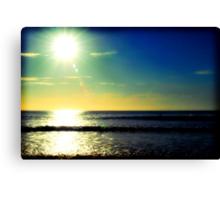 Surfing at sunrise Canvas Print