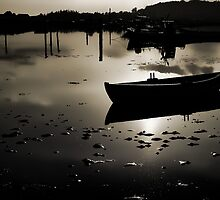 Reflection of a small dinghy dory boat by Ron Zmiri