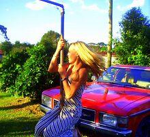 back yard pole dancer by Sam Ackling