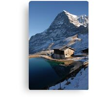 Eiger north face with small lake. Canvas Print