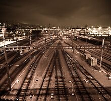 Train tracks in sepia by night. by peterwey