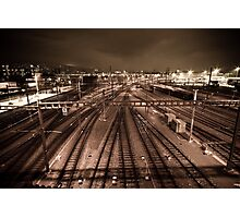 Train tracks in sepia by night. Photographic Print