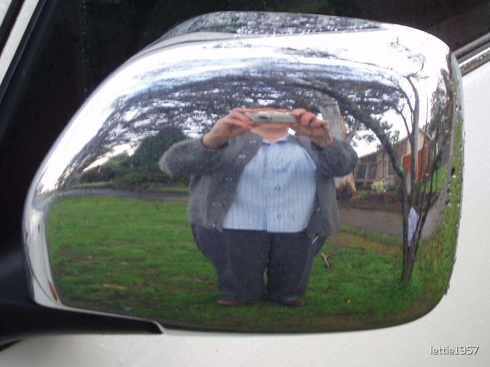 self portrait - through mirror on a car by lettie1957