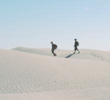 Walking alone in the Sahara desert Sticker