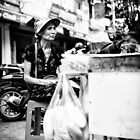 Local Lady in Hanoi by Oliver Winter