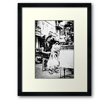 Local Lady in Hanoi Framed Print