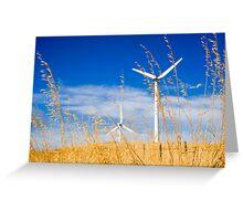 Wind farm generators over dry grass Greeting Card