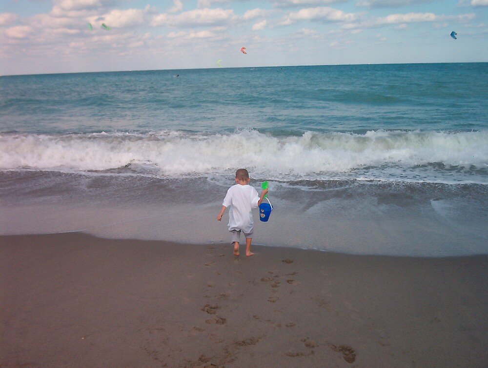 Child at beach - going to get more water by Patricia Harduby