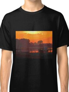 Boat in dramatic sunset Classic T-Shirt