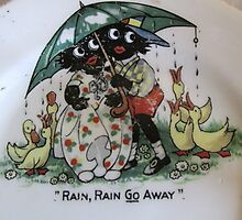 Golliwogs saying Rain Rain Go Away Photographic Print