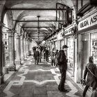 People under the arcades by Roberto Pagani