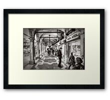 People under the arcades Framed Print