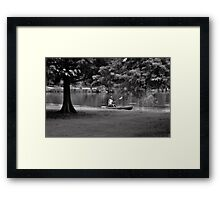 Afternoon out on the lake with a kayak Framed Print