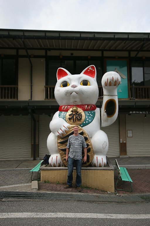 Cultural attache with lucky kitty sending vibes his way by Trishy