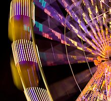 Illuminated ferris wheel by CatInTheFog