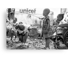 Street kids playing 'skippy' with disused iron bar, Democratic Republic of Congo Canvas Print