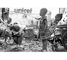 Street kids playing 'skippy' with disused iron bar, Democratic Republic of Congo Photographic Print