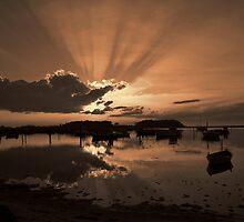 Boats in an amazing sunset by Ron Zmiri
