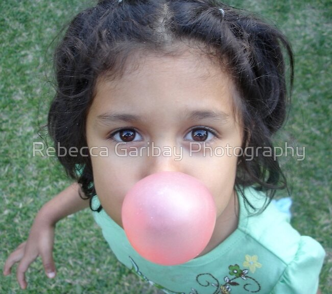 blowing a bubble by Rebecca Garibay Photography