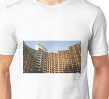 An unfinished apartment house. Unisex T-Shirt