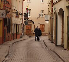 Man and woman  in love passes an empty street. by miniailov