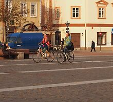 Couple running on bicycles in OldTown. by miniailov