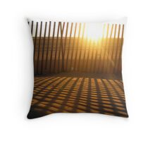 Fence creating sunlit stripes Throw Pillow