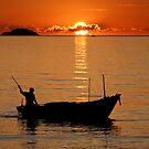 Fishing Boat At Sunset by Dave Lloyd