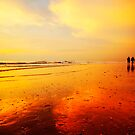 People walking on the beach by Enjoylife
