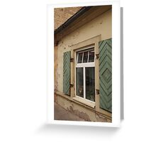 Dog is looking through a window of the house. Greeting Card