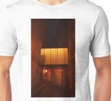 A tunnel between buildings at night. Unisex T-Shirt