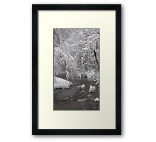 Freezing river, blanketed in snow Framed Print