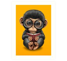 Cute Baby Chimpanzee Reading a Book on Yellow Art Print