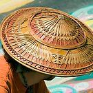 Artist's Hat-An artist is working on a chalk painting at the Imadinari Street Painting Festival.  Santa Barbara, California by Eyal Nahmias