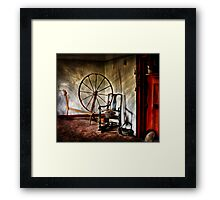 Spinning wheel and a chair Framed Print