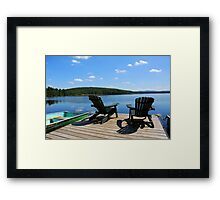 Chairs on dock Framed Print
