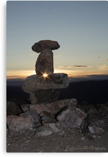 Midnight-Sun Through Inukshuk by Crokuslabel