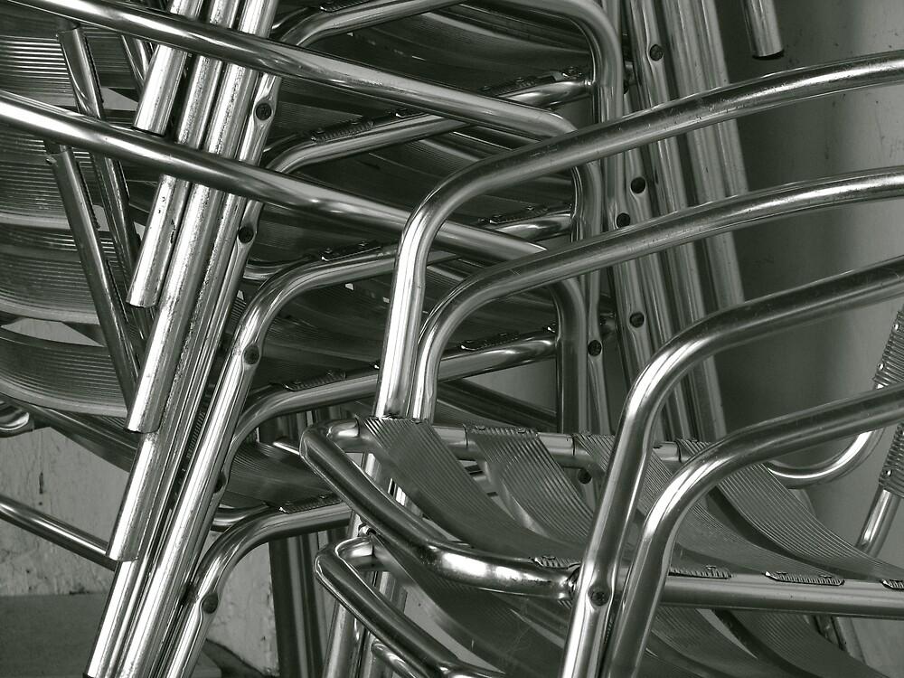 Stacked aluminium chairs at Bondi Beach by Lise Kool