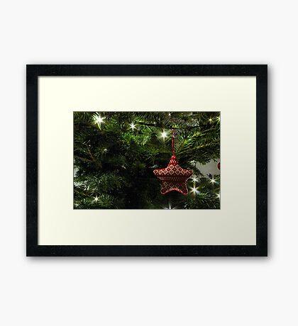 Knitted star Framed Print
