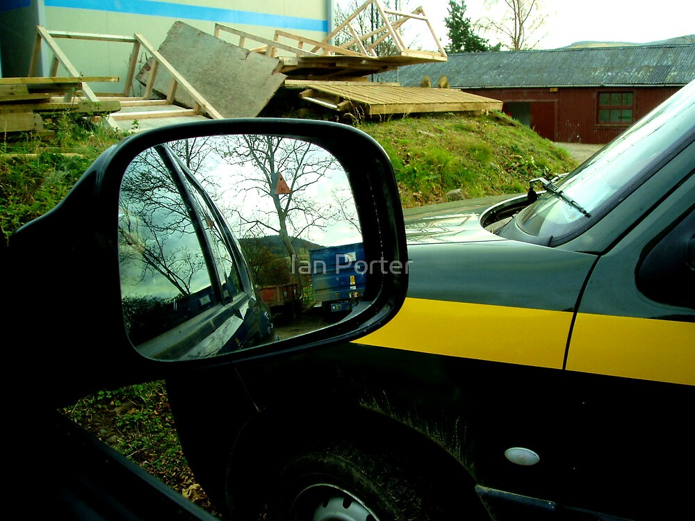Parked in The Hub Storage Area and a bird box in my car wing mirror by Ian Porter
