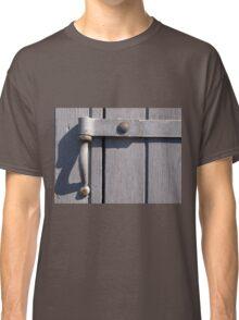 Closeup view of an old metal hinge Classic T-Shirt