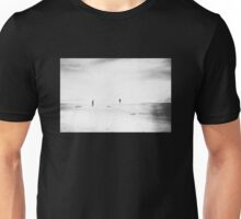 Man and woman are walking on the beach Unisex T-Shirt
