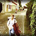 Boy Running Down A Stone Street #2 by Craig Schroeder